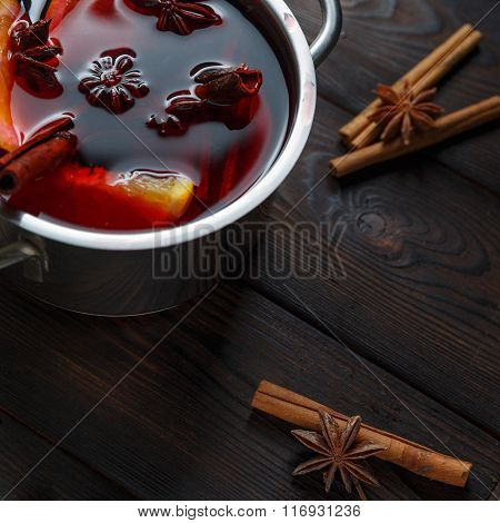Mulled wine on the dark old wood background