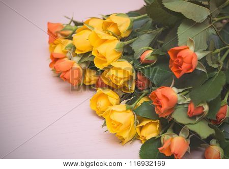 Yellow And Orange Roses On A Light Wooden Background. Women' S Day, Valentines Day, Mothers Day