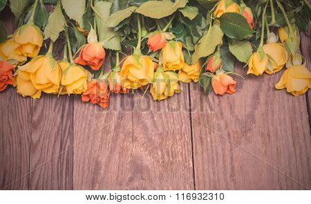 Yellow And Orange Roses On A Wooden Background. Women' S Day, Valentines Day, Mothers Day