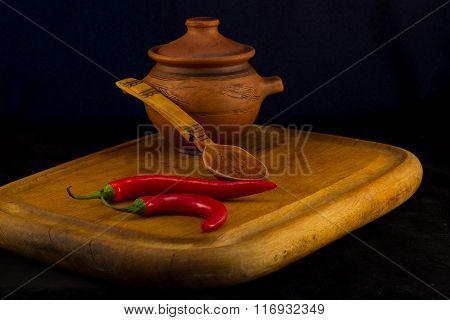 spoon with ceramic pot