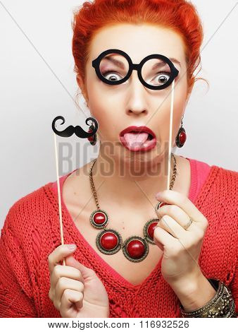young woman holding mustache and glasses