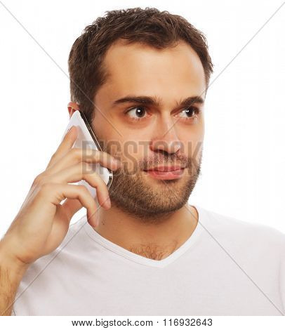 man in shirt speaking on the phone