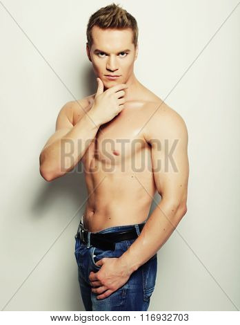 Sexy fashion portrait of a hot male model