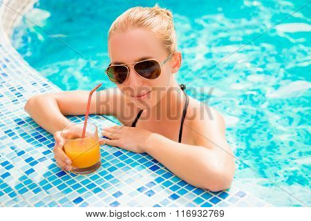 Sexy Girl Swimming In A Pool With Juice And Glasses