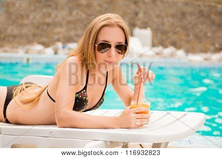 Sexy Slim Girl Lying On The Sunbed With Juice