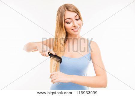 Pretty Cute Girl Combing Her Hair