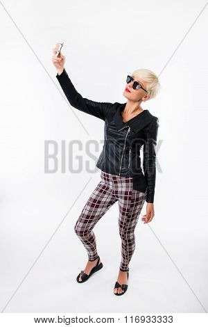 Sexy Trendy Woman  Making Selfie On The Phone