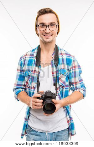 Young Smiling Photographer In Glasses With Camera In His Hands