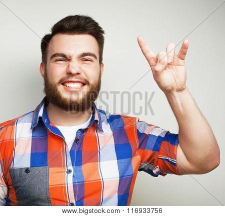 man showing heavy gesture
