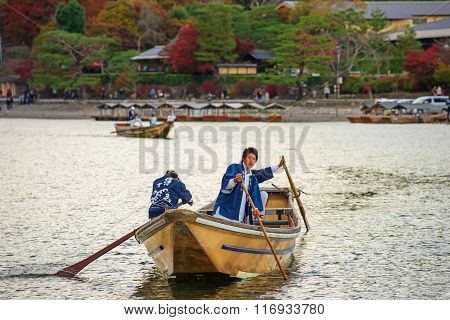 Japanese Oar People Sail Boat At Arashiyama