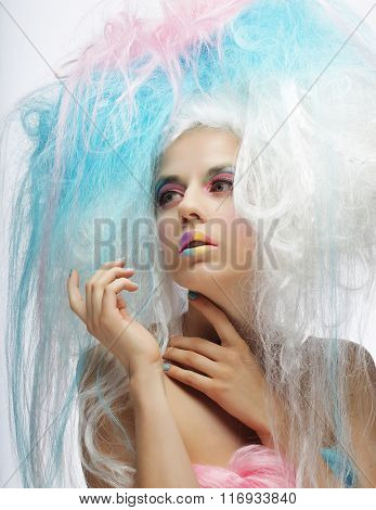 fashion model with bright make up and colorful hair