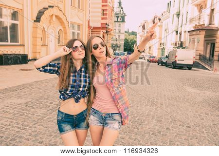 Stylish Girls Looking At The City On A Tour