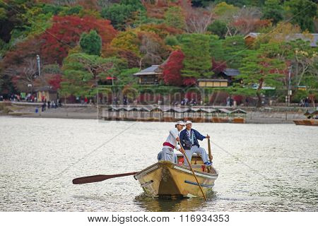 Japanese Boatman Sail Boat To Enjoy Autumn Leave