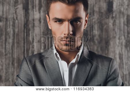Attractive Man In Business Suit On The Grey Background