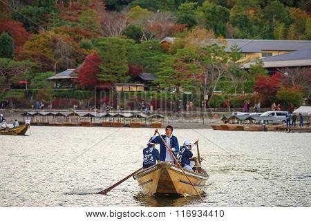 Japanese Men Sail Boat For Tourist At Arashiyama