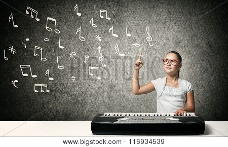 Kid girl play synthesizer