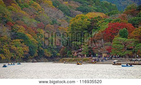 Japanese People Sailing Boats At Arashiyama