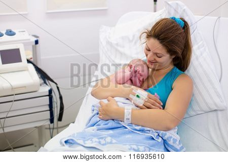 Young Mother Giving Birth To A Baby