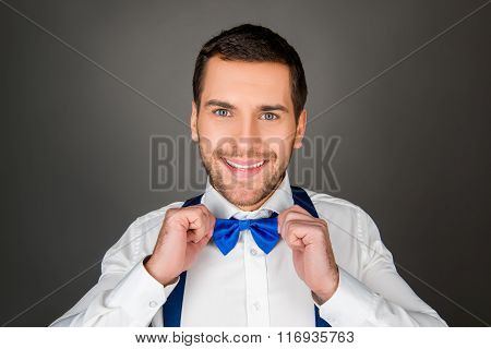 Smiling Man Binding A Bow