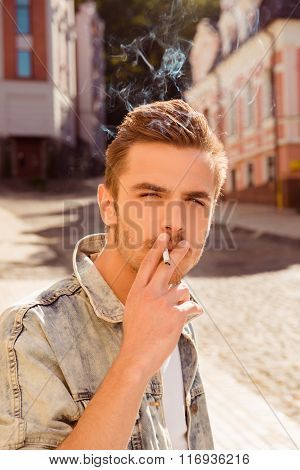 Portrait Of Handsome Man With Cigarette Smoking
