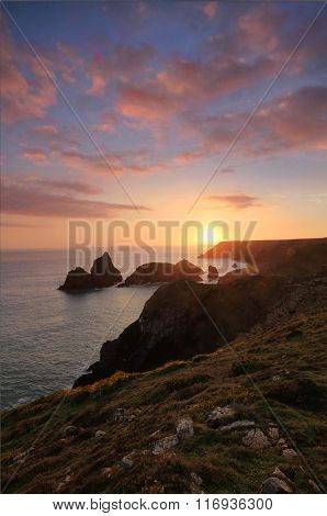 Sunset Over Rugged Cliffs In Cornwall