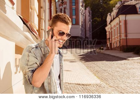 Handsome Man In Glasses Talking On Phone On The Street