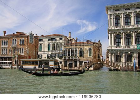 Venice, Italy - September 02, 2012: Gondola With Tourists Near Palazzo Ca' Rezzonico On Grand Canal,