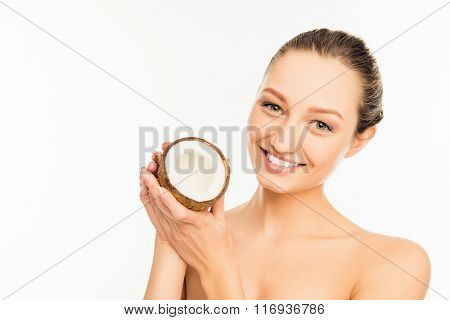 Cute Smiling Girl Holding Half Of Coconut In Hands