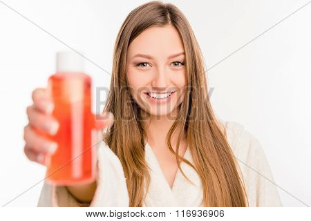 Close Up Photo Of Cute Girl  Holding Red Lotion