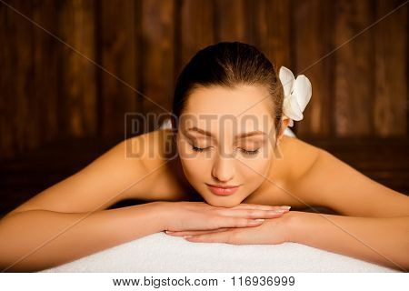 Attractive Young Girl Lying With Closed Eyes In Sauna
