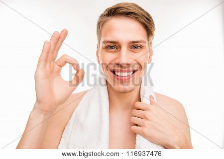 Handsome Funny Young Man With Towel Gesturing Ok