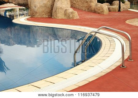 Steps In Blue Water Pool