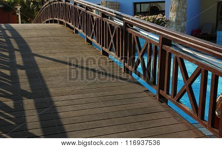 Blue Water In The Pool With The Bridge