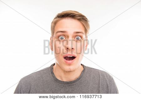 Portrait Of Surprised Handsome Man In Gray T-shirt