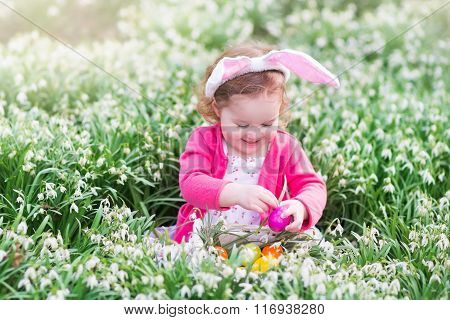 Little Girl With Bunny Ears On Easter Egg Hunt