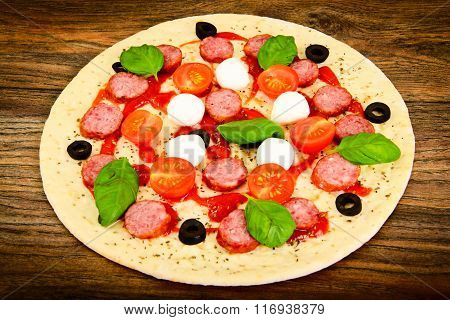 Raw Pepperoni Pizza with Sausage, Cheese, Mozzarella, Olives and