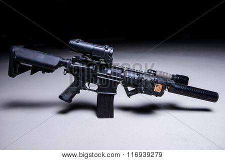Assault Rifle With Silencer And Optical Scope.