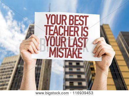 Your Best Teacher Is Your Last Mistake placard with urban background