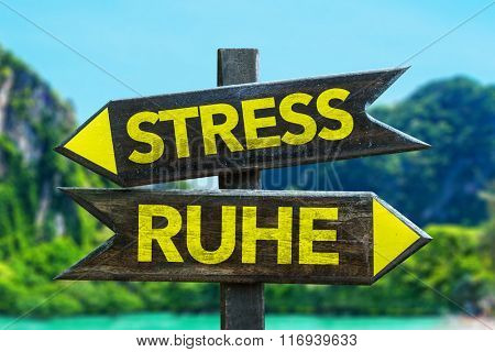 Stress - Peace (in German) signpost in a beach background
