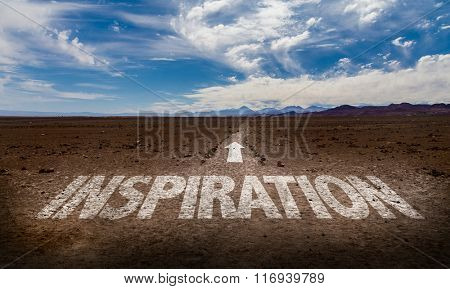 Inspiration written on desert road