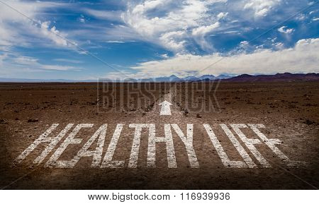 Healthy Life written on desert road