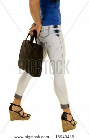 Woman With Briefcase In Denim Jeans Legs Back