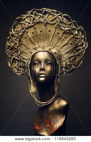 Mannequin in golden headwear