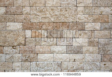 Elegant stone wall from small rectangular parts