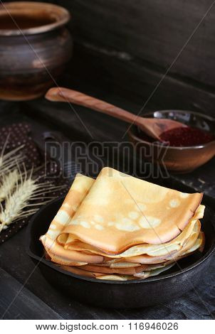 Stack Of Pancakes In A Cast Iron Skillet