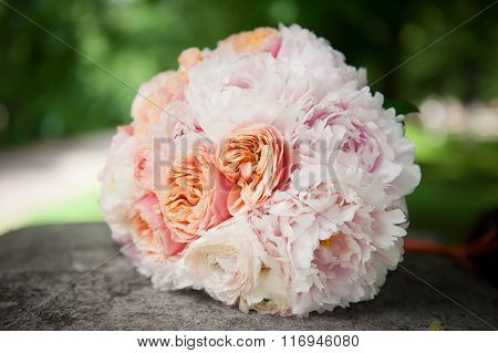 Delicate bouquet with roses in pastel colors