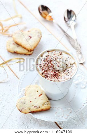 Cup Of Coffee With Cream On A White Background