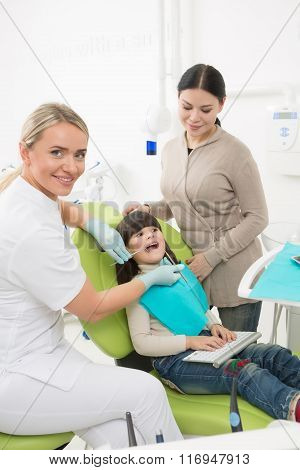 Little girl with her mother at dentist's office