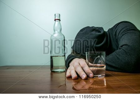 Drunk man lies on the table