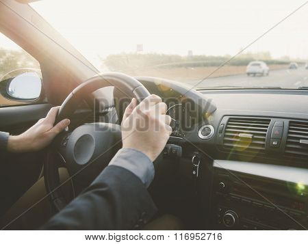 Arms Of A Man Driving